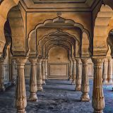 Ornate carved stone pillars in Amber Fort